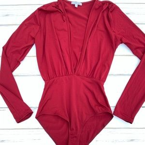 Charlotte Russe Low V Cut Long Sleeve Body Suit